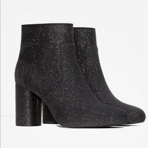 Black glitter booties.